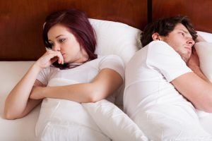 29804657 - people lying together but separately because of marital problems